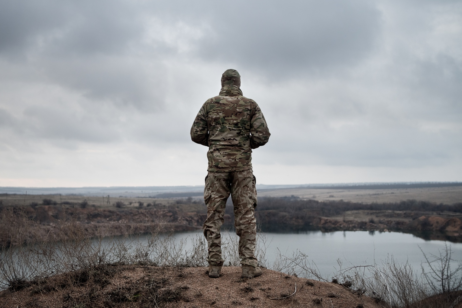 OVER THERE - Volnovakha, Donbas (Ukraine) December 15, 2018 A Ukrainian soldier from the 128 Mechanized Brigade observes the areas occupied by the separatists north of Volnovakha, in the Donbas. On the horizon, the southern front line that reaches Shyrokyne, on the Azov Sea. According to observers of the OSCE SMM international mission, heavy weapons prohibited by the Minsk agreements are often used in combat. This area is considered strategic for the conquest of Mariupol, home of the most important steel plants in the country: the occupation of the town, already invaded by the pro-Russians in 2014 and then freed, would allow separatists to create a corridor to connect Lugansk and Donetsk to Crimea, the Ukrainian peninsula which in 2014 declared independence thanks to Russia's political and military support.